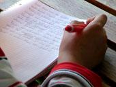 Schreibendes Kind (c)schemmi, www.pixelio.de
